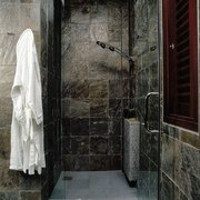 A shower in a natural situation - A bathroom, plumbing fixture, room, wall, window, black, gray