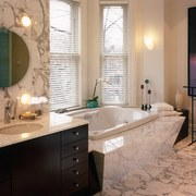 View of the bathtub & marble decorative - bathroom, cabinetry, countertop, home, interior design, room, orange, gray