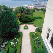 Formal garden with boxed hedging, white pebble path, estate, garden, grass, green, hedge, house, landscape, landscaping, lawn, plant, property, real estate, shrub, tree, green