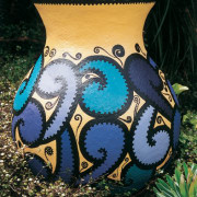Urn decorated with Resene test pots by Dianne black