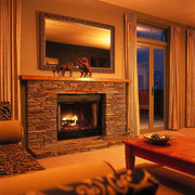 Indoor fireplace with stone surrounds, mirror above mantlepiece, fireplace, hearth, heat, home, interior design, living room, room, wood burning stove, brown