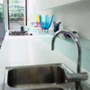The detail of a sink and benchtop of countertop, furniture, glass, interior design, product design, table, tap, gray, white