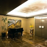 View of the entrance to this home - ceiling, floor, interior design, lobby, wall, brown