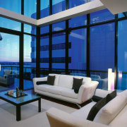 View of the living area - View of blue, ceiling, condominium, daylighting, home, interior design, living room, penthouse apartment, property, real estate, window, blue, gray