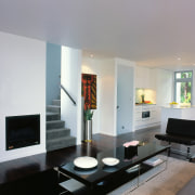 View of the living space & stairway - furniture, hearth, interior design, living room, room, table, gray