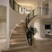 View of the stairway - View of the baluster, floor, flooring, handrail, interior design, lobby, stairs, brown, gray