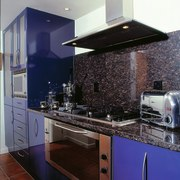 View of the kitchen area - View of cabinetry, countertop, interior design, kitchen, kitchen stove, room, black