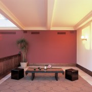 View of the room colour - View of ceiling, daylighting, floor, flooring, furniture, hardwood, home, interior design, lighting, living room, property, real estate, room, table, wall, wood, red, orange
