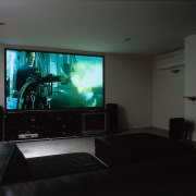 A home theatre system - A home theatre ceiling, display device, electronic device, flat panel display, home, home cinema, house, interior design, multimedia, room, technology, black