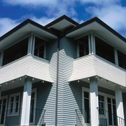 Two storey weatherboard house with balconies and columns. architecture, building, commercial building, elevation, facade, home, house, property, real estate, residential area, roof, siding, window, black