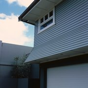Two storey weatherboard house with flared overhang over architecture, building, daylighting, facade, home, house, line, property, real estate, residential area, roof, siding, sky, window, black