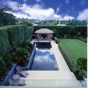 The pool adjoins a large flat lawn. - architecture, cloud, estate, grass, house, landscape, property, real estate, reflecting pool, roof, sky, swimming pool, water, water feature, water resources, blue