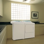 View of laundry with washing machine and clothes cabinetry, clothes dryer, countertop, home appliance, kitchen, laundry, laundry room, major appliance, product, product design, room, sink, washing machine, brown, white
