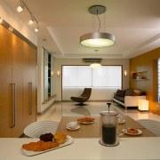 The living area & table - The living ceiling, floor, interior design, lighting, living room, real estate, room, brown, orange