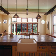 The view over a rural kitchen's island to cabinetry, ceiling, countertop, daylighting, estate, flooring, hardwood, home, interior design, kitchen, real estate, room, window, gray, brown