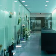 This boutique displays flowers in a variety of architecture, ceiling, glass, interior design, lobby, teal