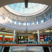 This food hall is on the second floor building, ceiling, daylighting, metropolitan area, retail, shopping mall, gray, white