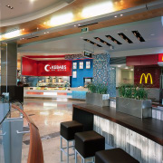 Food outlets are on the outer curved wall cafeteria, fast food restaurant, food court, interior design, restaurant, retail, gray