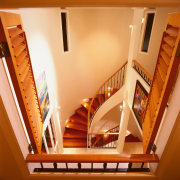 Stairway with wooden steps, cream walls, and wooden baluster, ceiling, daylighting, floor, flooring, handrail, hardwood, home, house, interior design, stairs, wood, orange, brown