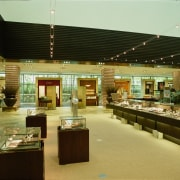 Leather goods watches and jewellery are displayed in food court, interior design, brown