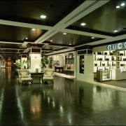 Fashion houses display their merchandise in boutiques that interior design, tourist attraction, brown