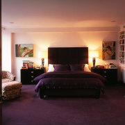 master bedroom where purple tones are a feature. bed, bed frame, bedroom, ceiling, furniture, home, interior design, lighting, room, suite, wall, window, black