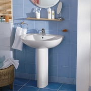Bathroom with blue floor and wall tiles, white angle, bathroom, bathroom accessory, bathroom sink, ceramic, floor, flooring, interior design, plumbing fixture, product, product design, public toilet, room, sink, tap, tile, toilet, toilet seat, wall, blue, gray