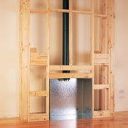 Wooden framing for installing a gas fireplace against bookcase, cabinetry, cupboard, floor, furniture, hardwood, shelf, shelving, wall, wardrobe, wood, wood stain, orange