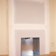 Fire box and mock chimney being installed against fireplace, floor, hardwood, hearth, interior design, plaster, wall, wood, white, orange