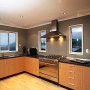 Kitchen with wooden cabinetry, black benchtop, stainless steel cabinetry, countertop, cuisine classique, floor, flooring, hardwood, interior design, kitchen, real estate, room, wood flooring, brown, orange