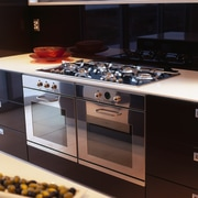 Kitchen with black cabinetry, cream benchtop and stainless countertop, gas stove, home appliance, kitchen, kitchen appliance, kitchen stove, major appliance, black
