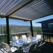 View of the balcony with dining area - daylighting, lighting, outdoor structure, patio, real estate, roof, shade, black, gray