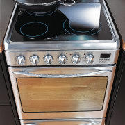 Freestanding electric oven with ceramic cooktop, in a gas stove, home appliance, kitchen appliance, kitchen stove, major appliance, oven, stove, black