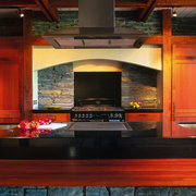The detail of the oven area of a countertop, interior design, kitchen, red, black