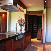 The view of a wine cellar from the cabinetry, ceiling, countertop, cuisine classique, flooring, hardwood, home, interior design, kitchen, room, wood, red
