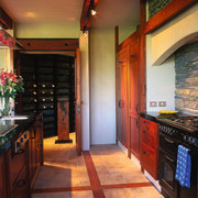 The view of a kitchen featuring a mix cabinetry, countertop, flooring, interior design, kitchen, real estate, room, black