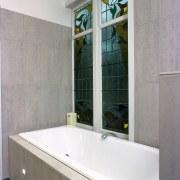 The detail of a bath tub of a bathroom, bathroom accessory, interior design, property, room, tile, window, gray