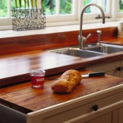 The detail of a chopping board that pulls countertop, furniture, kitchen, sink, table, brown