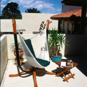 The Hammock Chair Recliner from Hammock World fits chair, furniture, house, leisure, outdoor furniture, sunlounger, table, vacation, water, white