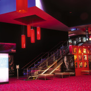 Westfield St Lukes Village SkyCity cinema. Plush carpet architecture, auditorium, light, lighting, night, red, black, red