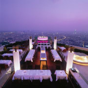 View of the rooftop diner - View of architecture, city, landmark, night, sky, structure, purple