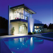View of the pool area - View of architecture, estate, facade, home, house, lighting, property, real estate, reflection, residential area, sky, swimming pool, villa, water, window, blue