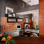 View of the desk area of this kitchen furniture, interior design, living room, loft, room, wall, gray, black