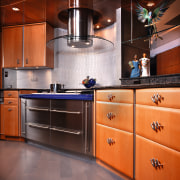 Inner view of the kitchen cabinetry & appliances cabinetry, countertop, cuisine classique, flooring, hardwood, home appliance, interior design, kitchen, kitchen stove, room, under cabinet lighting, orange