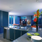 Kitchen with stainless steel countertops, double sinks and ceiling, countertop, interior design, kitchen, room, blue, gray