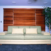 A view of the Hamilton settee in Kiribati couch, furniture, home, interior design, living room, wall, window, window blind, window covering, window treatment, wood, blue