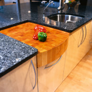 Close view of the built-in chopping board - countertop, floor, flooring, furniture, hardwood, material, table, wood, wood stain, orange