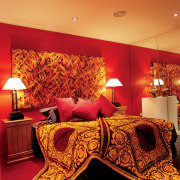 View of this bedroom - View of this bed sheet, bedroom, ceiling, interior design, modern art, orange, room, suite, wall, red, orange