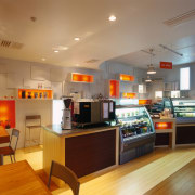 Counter area of food bar with timber cabinets, ceiling, interior design, kitchen, brown, orange