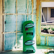 View of a bag of GreenStuf insulation. There green, wall, window, green